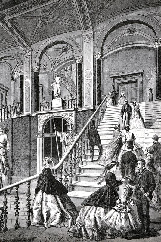 Ah! Vilken trappa! Nationalmuseums nya trapphus 1866. Här kunde man nu känna sig som i stora världen, dvs på den tiden Europa. Asaguden Odin i marmor av skulptören Bengt Erland Fogelberg (1786 – 1854), stirrar något förbluffat på den florentinska prakten från sin plats vid räcket.
